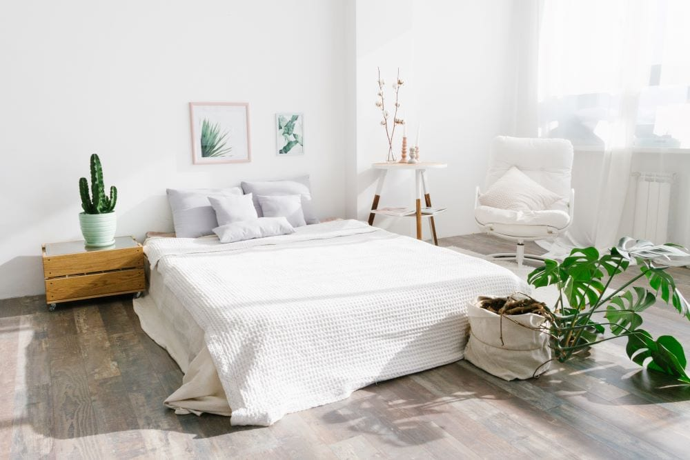 White bedroom with green accents