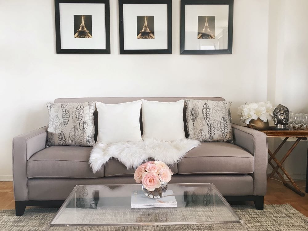 Living room interior design, flowers as centerpiece of coffee table