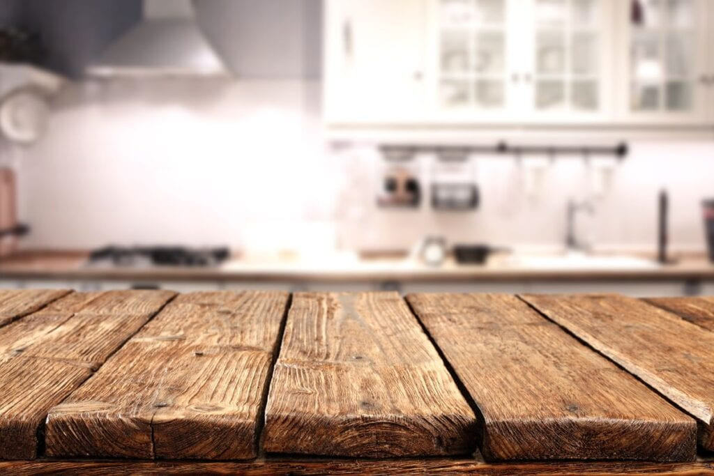 Close up of worn wood table in kitchen