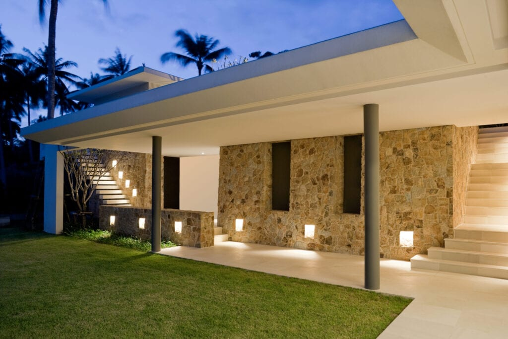 Outdoor Entrance, Walkway And Courtyard Of A Tropical Home.