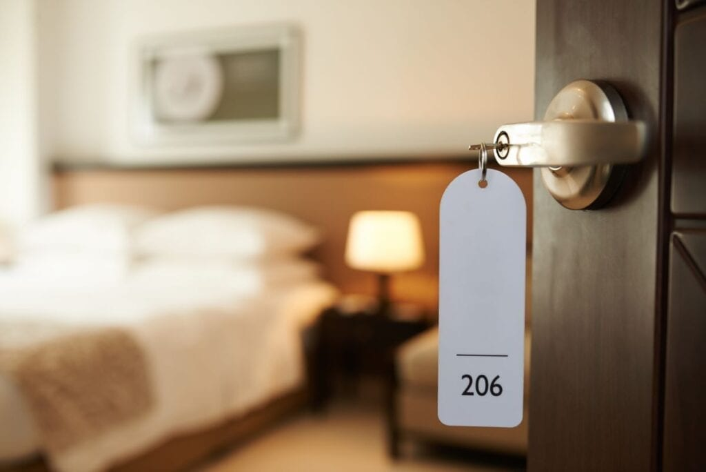 Hotel room with key in lock
