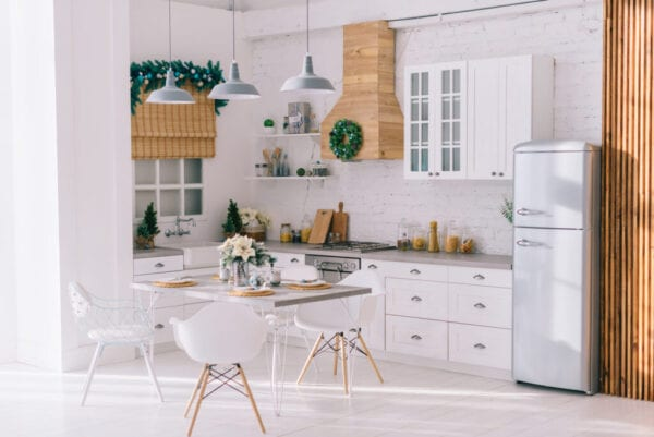 Interior of a bright modern kitchen in vintage style, decorated with Christmas decor, general plan