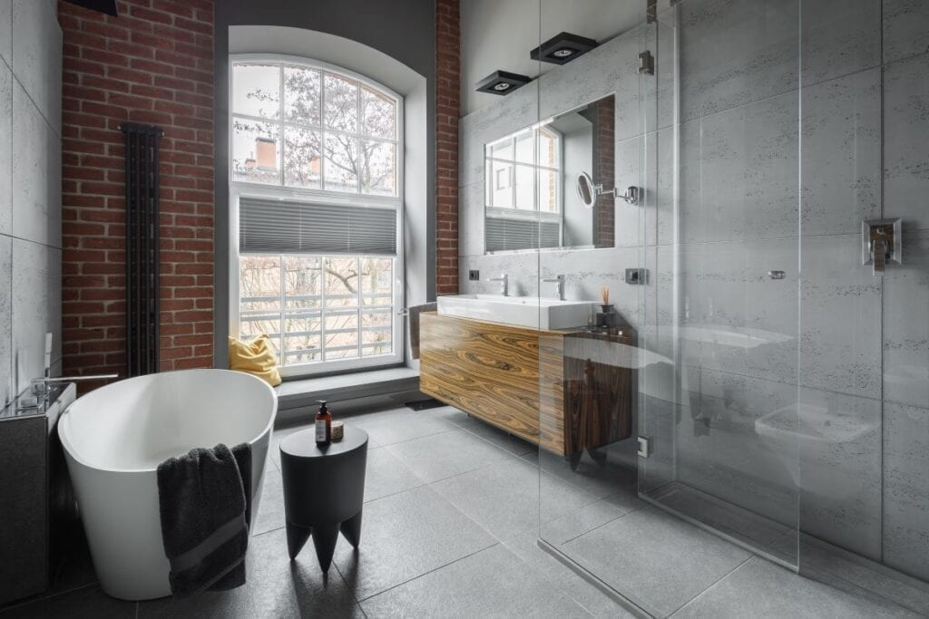 Industrial style bathroom with exposed brick wall