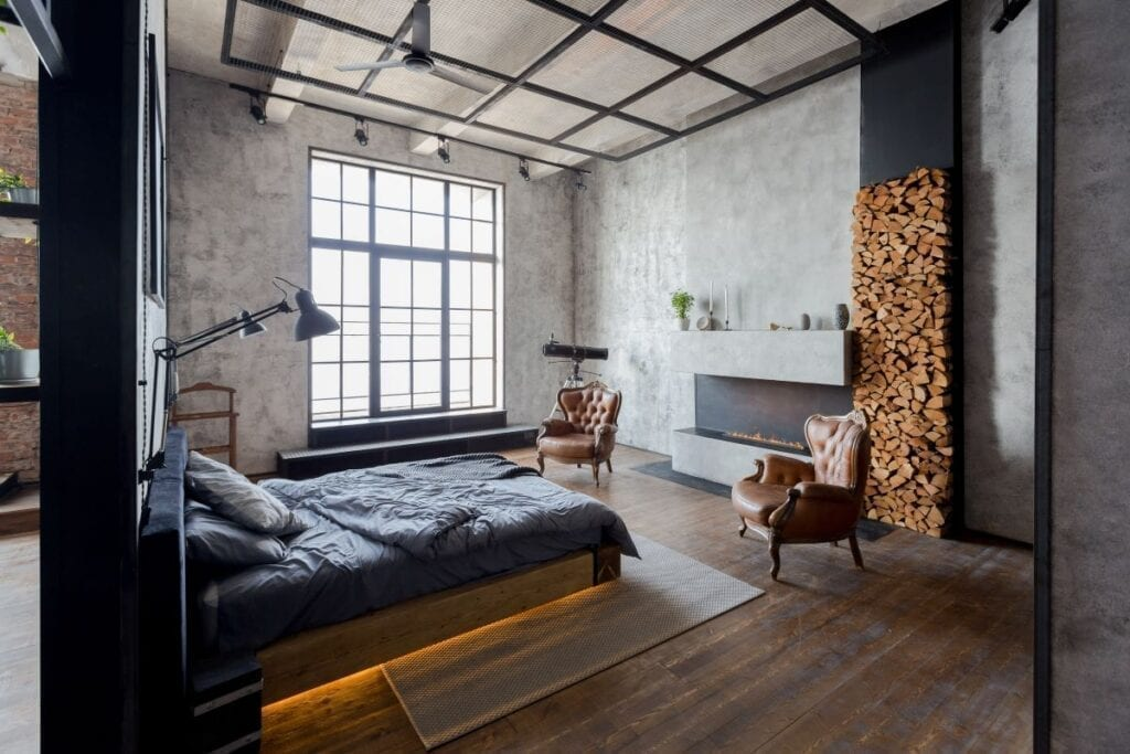 Luxurious industrial style bedroom with fireplace and large windows