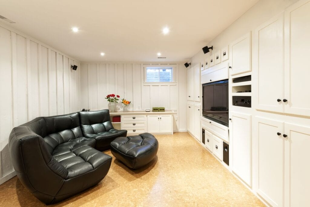Finished basement with cork flooring and white painted walls