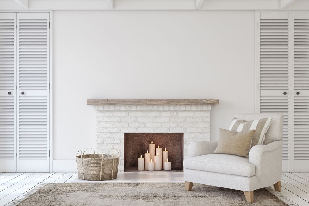 Candles in fireplace, white living room