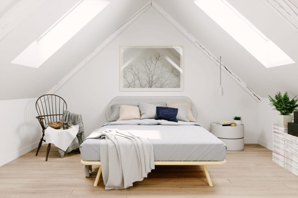 Interior of a Scandinavian style attic bedroom.