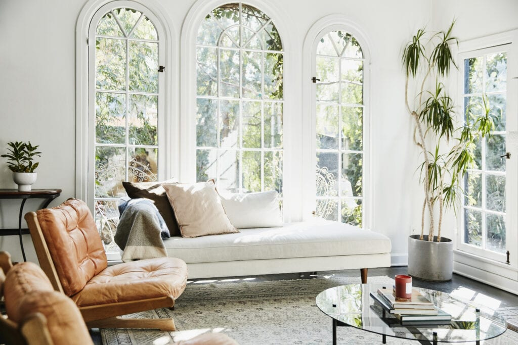 Living room with large windows and white daybed