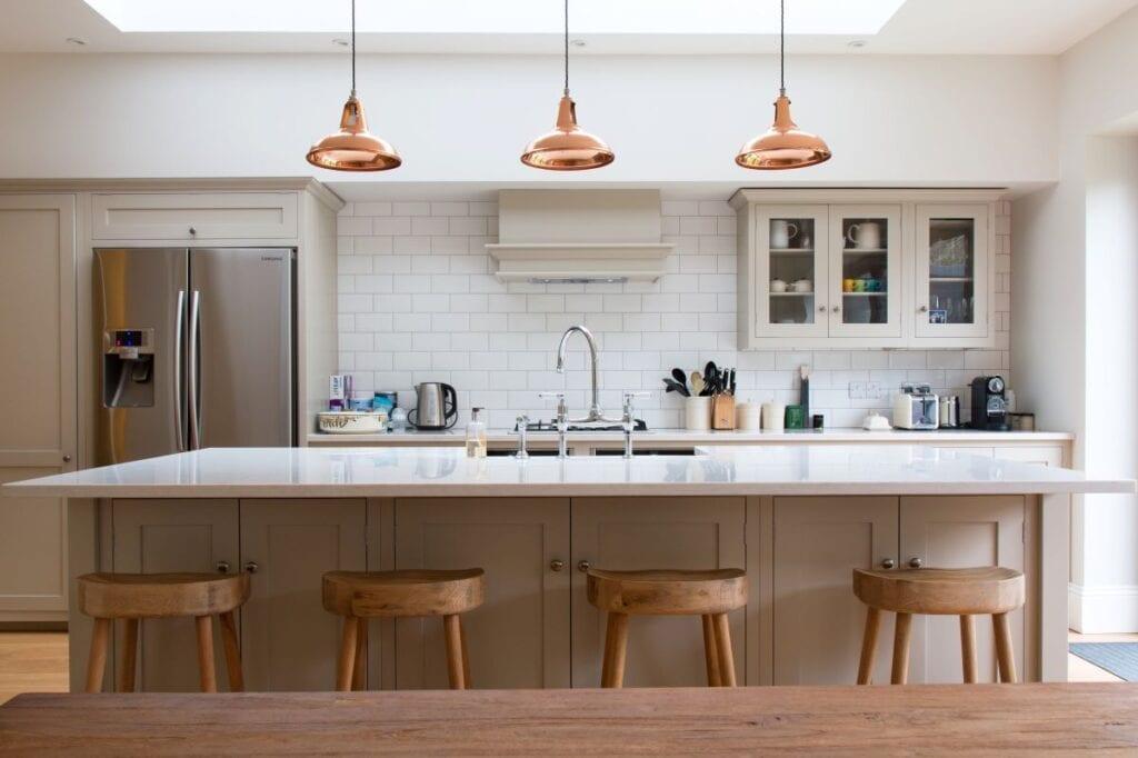 Interior of minimalist kitchen with subway tile backsplash