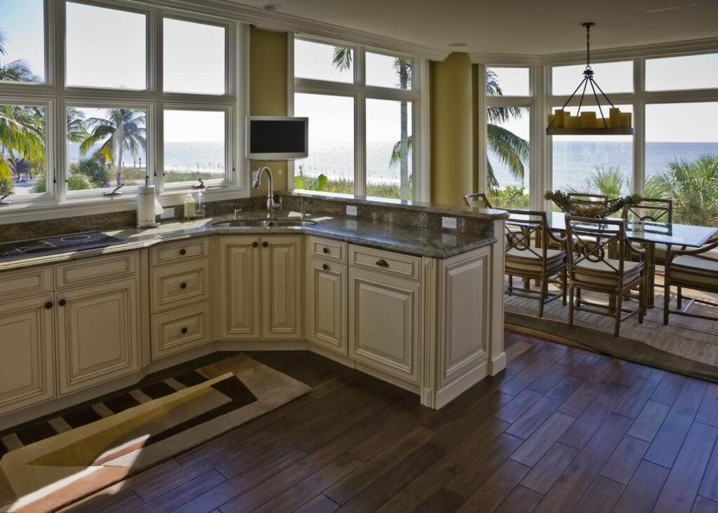 Interior of a beach house in Florida on the Gulf of Mexico.  The kitchen and dining room have a beautiful view of the beach.
