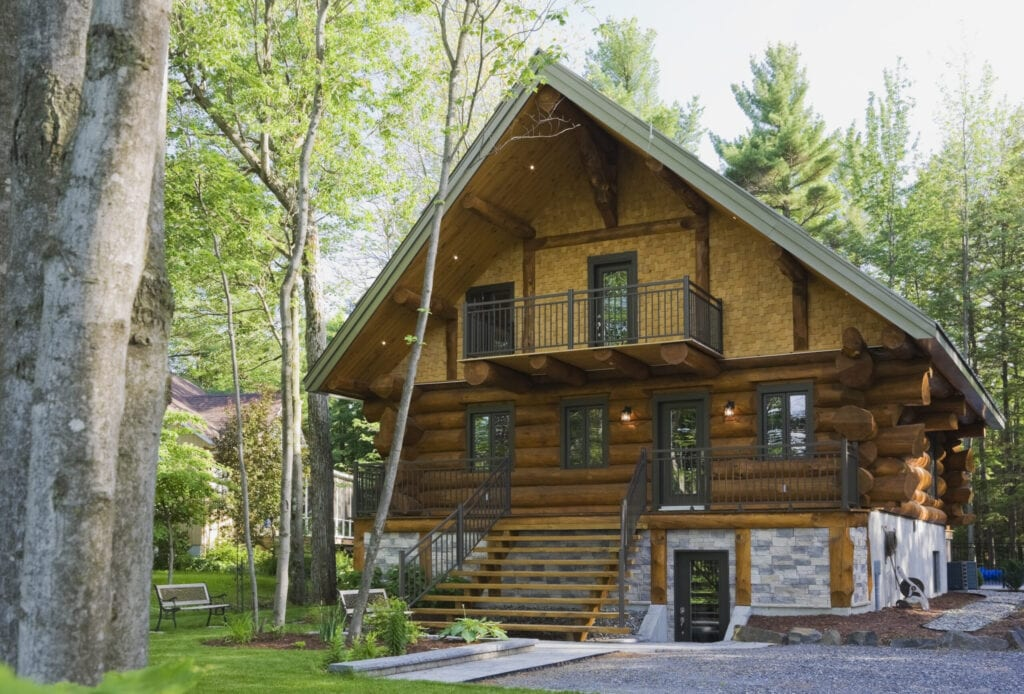 Luxurious Scandinavian cottage style log home facade in late spring, Quebec, Canada. This image is property released. CUPR0276
