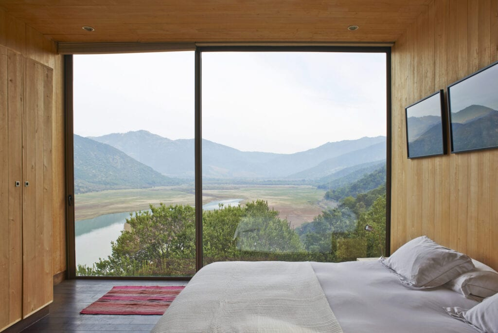 Hotel room with panoramic view of the vineyards in San Vicente, Chile; Vina Vik Retreat