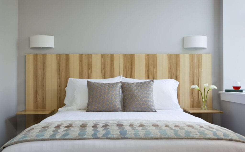 Bed and custom headboard, Ledges Boutique Hotel - Settlers Inn, Hawley, PA, USA