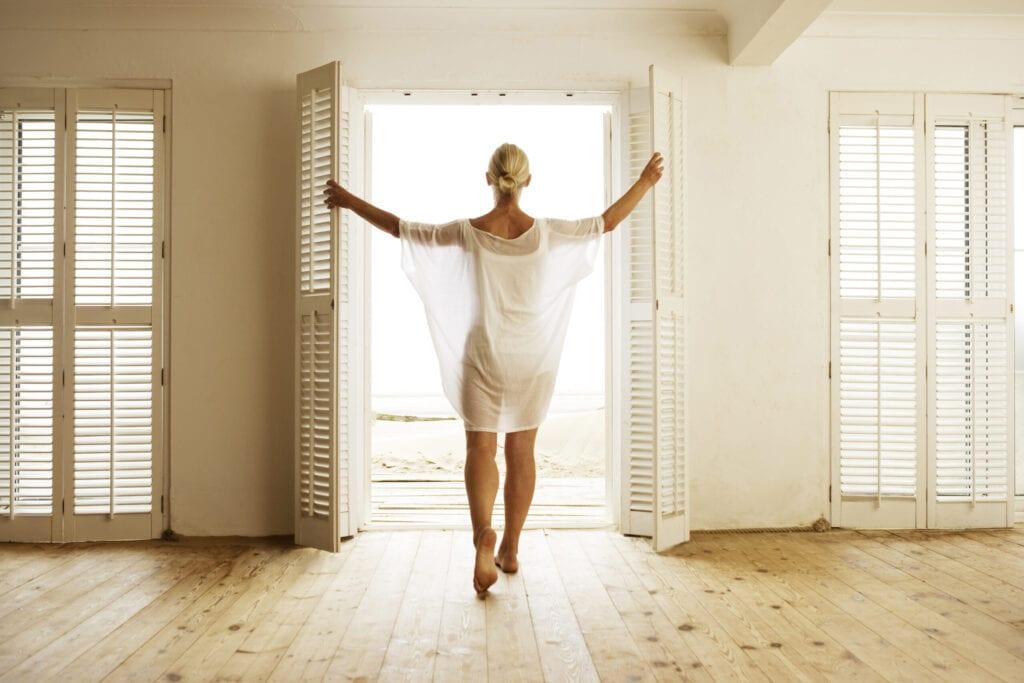 woman in beach house