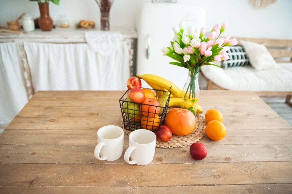 citrus fruits in a wire basket on a table