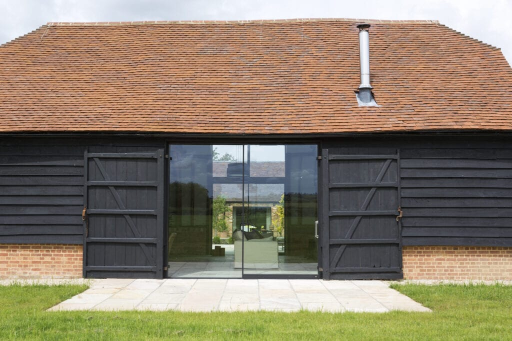 Glass sliding doors of converted barn home