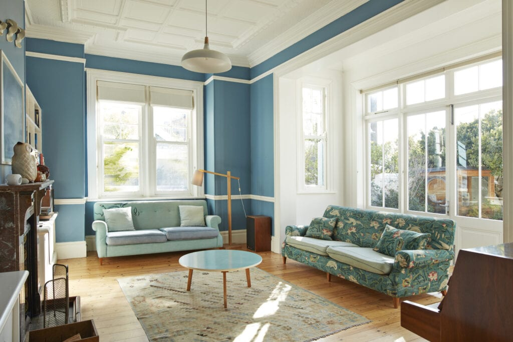 Living room with blue couches and walls