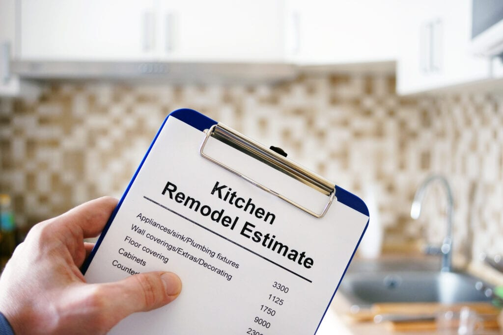 Clipboard with Kitchen remodel estimate. Cost of renovation.