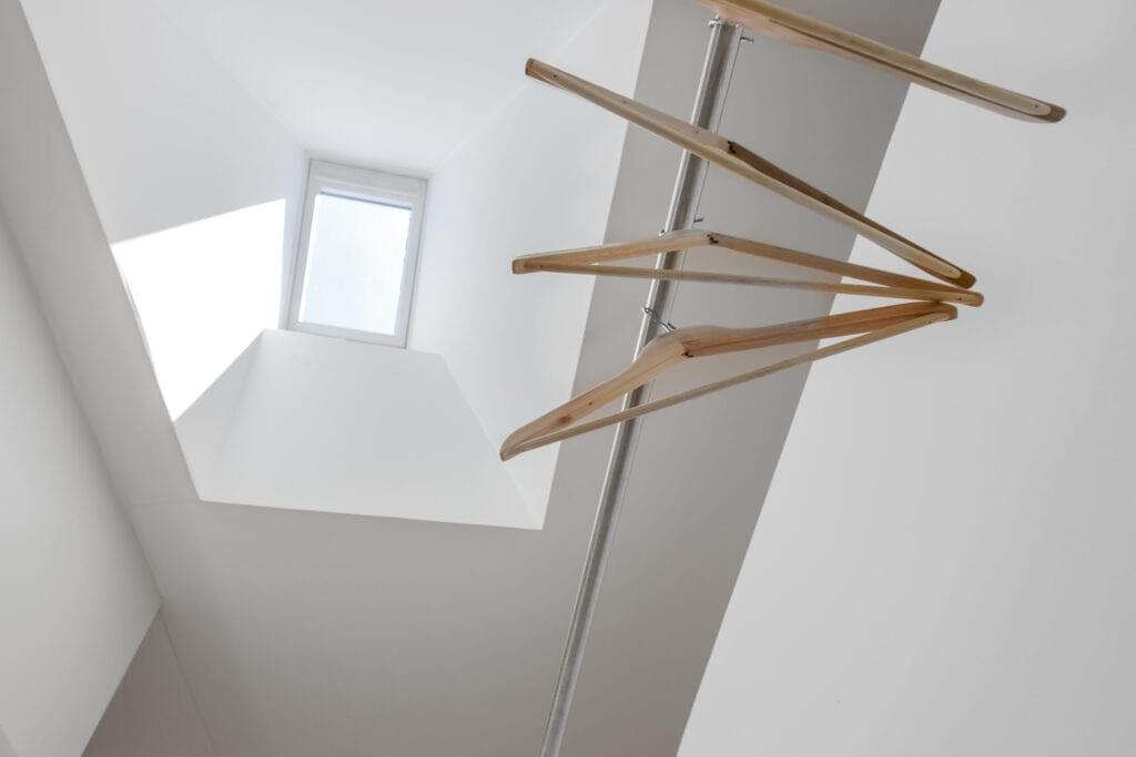 Clothes hanger under skylight
