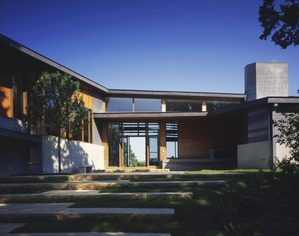 A breezeway with doors on both sides allows one to see through this modern home.