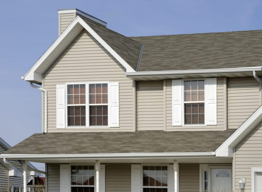 If you require a shot of a new home or any of the array of building products shown, this would be a great image for you. It shows, architectural asphalt shingle roof, vinyl siding, windows, vinyl shutters, seamless aluminum gutters.