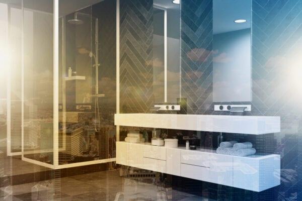 White sink vanity unit in a black bathroom toned