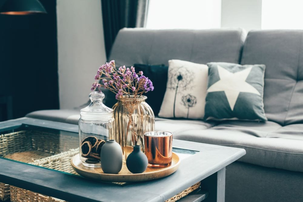 Close up of table in front of couch, interior design and decor