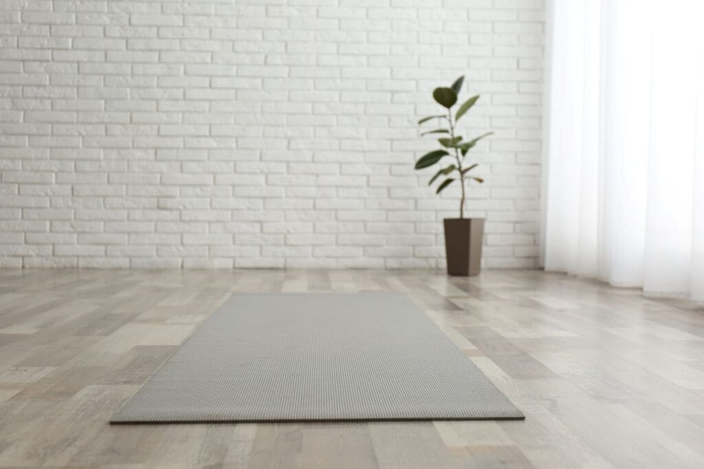 Crisp white yoga room with yoga mat and no clutter