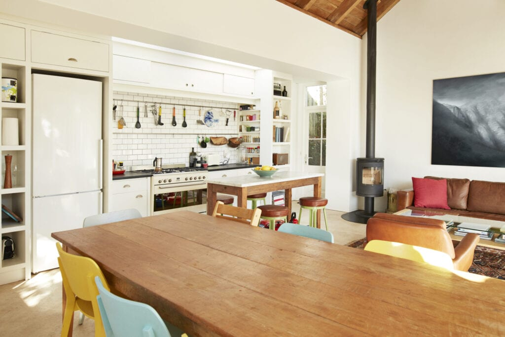 Wooden dining table arranged against kitchen counter at home