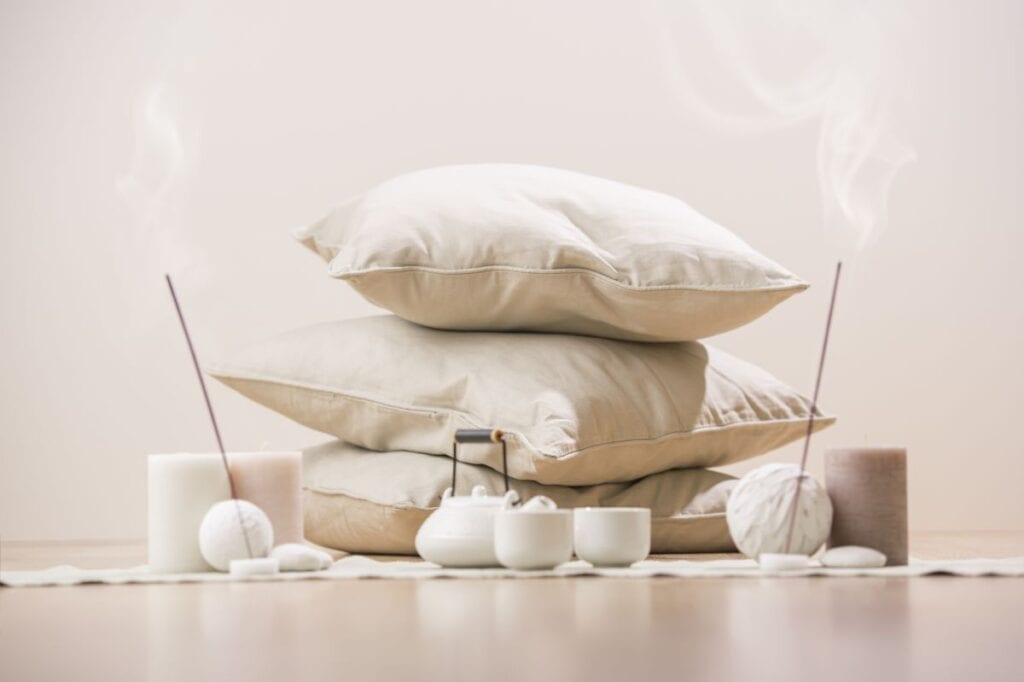 Home meditation items, incense, pillows, and teapot
