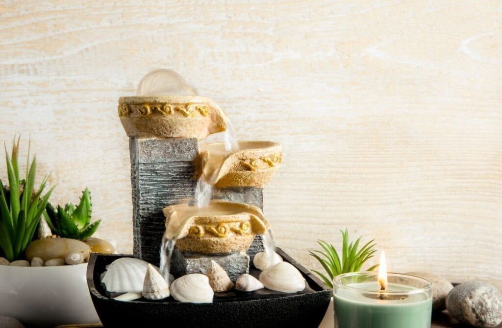 Indoor water fountain with rocks for meditation