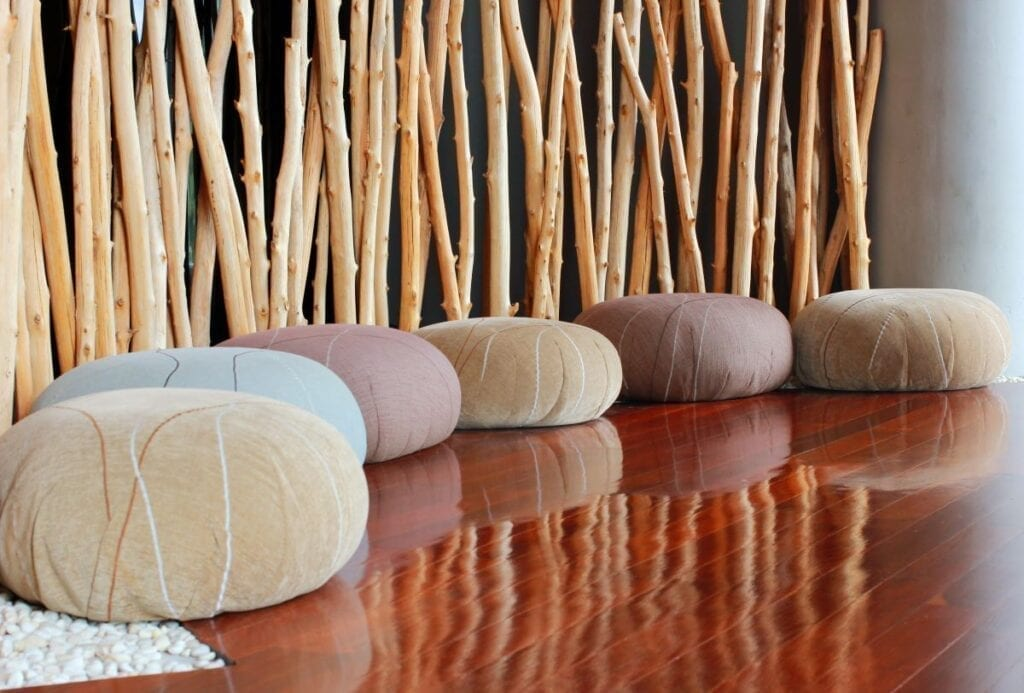 Meditation room with floor cushions and bamboo