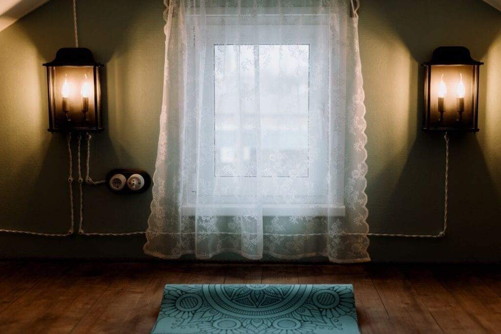 Yoga or meditation room with window and dim lights