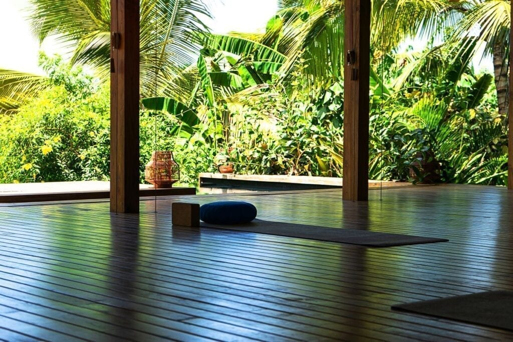 Tropical outdoor meditation room with yoga mats