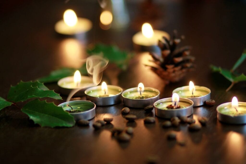 Scented candles with pinecones and coffee beans