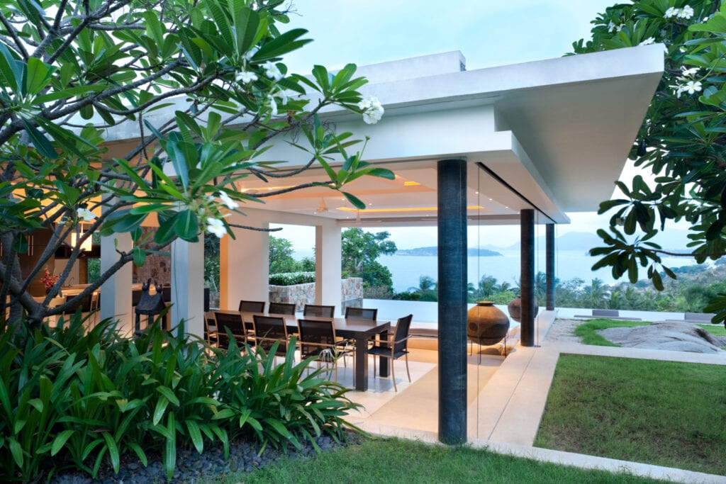 Modern Villa In The Tropics In The Early Morning At Sunrise.