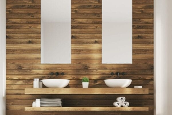 Bathroom with double sinks, long mirrors, and floating shelves for storage