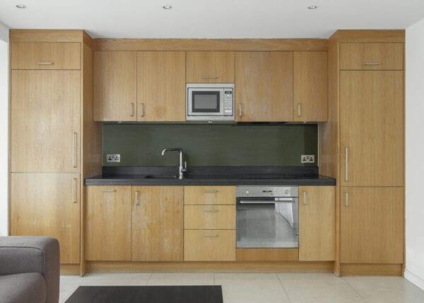 Wood kitchen in modern apartment