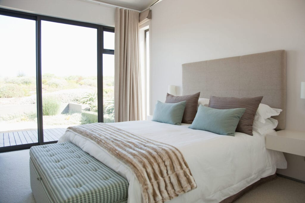 modern bedroom blue and tan