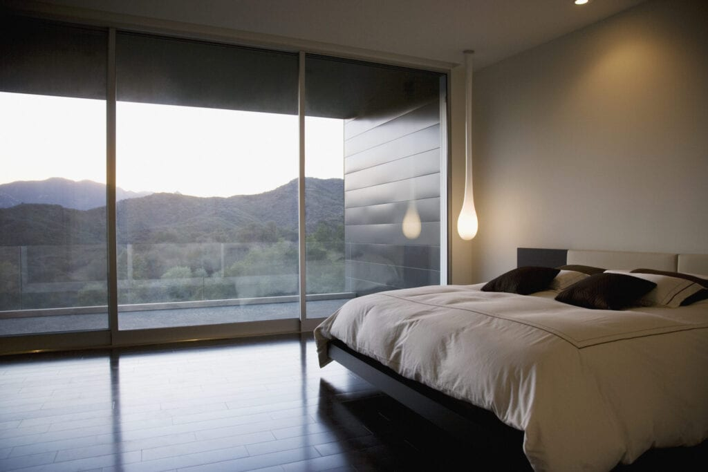 Modern bedroom and glass wall