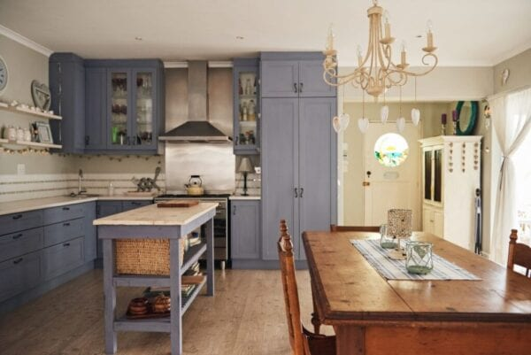 Country style kitchen with a sofa table used as an island