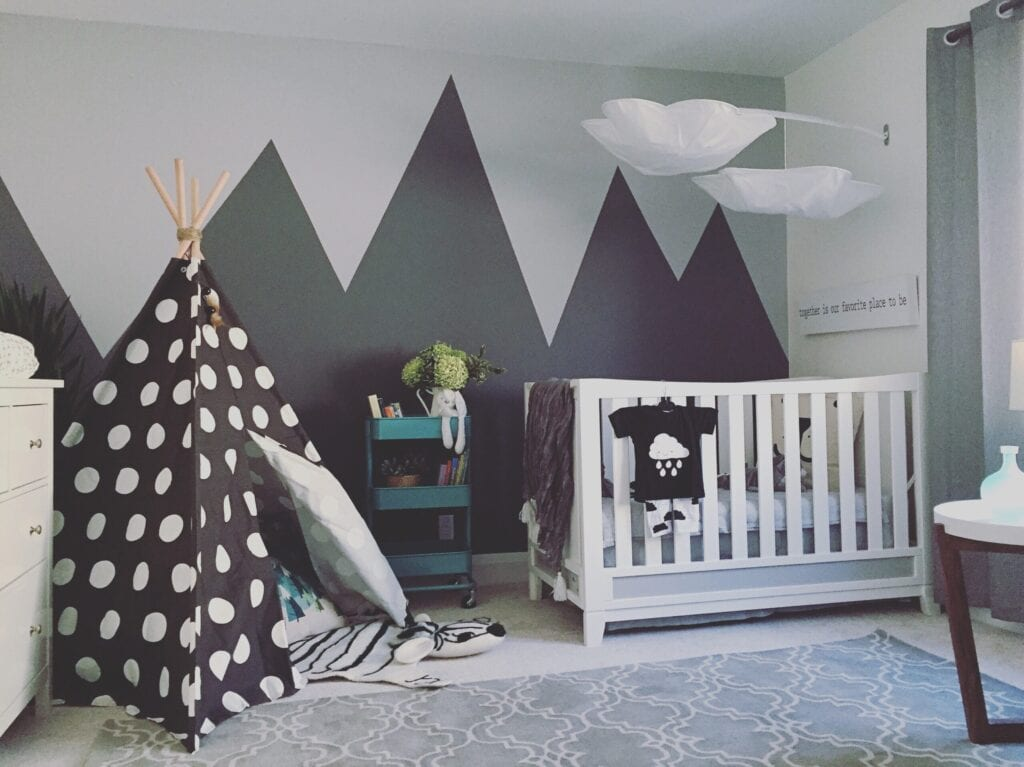 grey baby room with mural