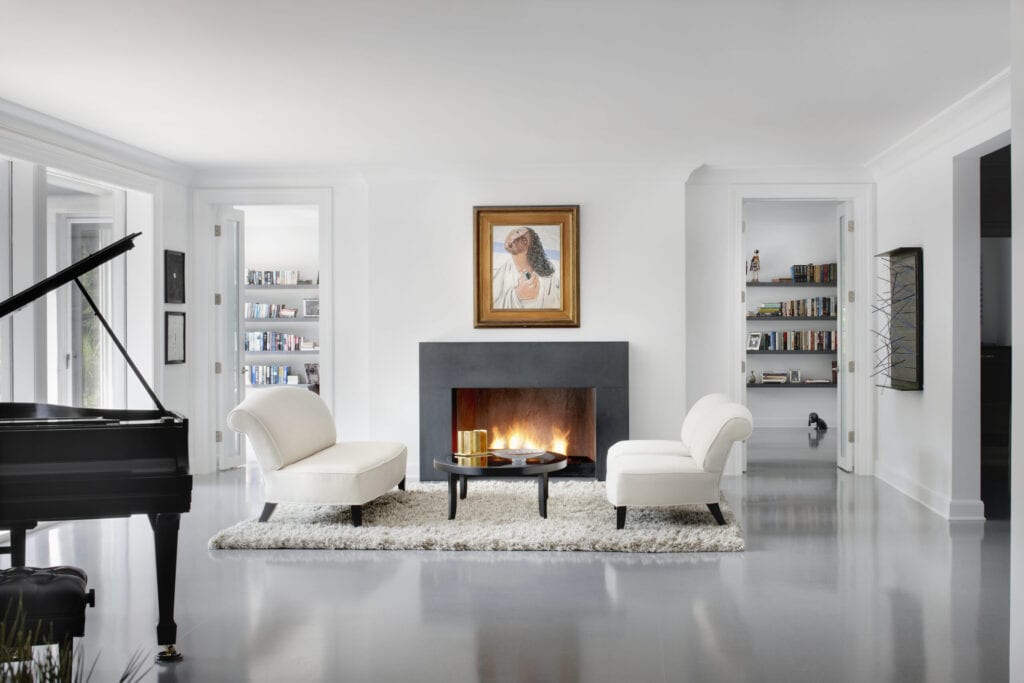 Modern family room with glowing fireplace and grand piano in this Chicago IL residence.