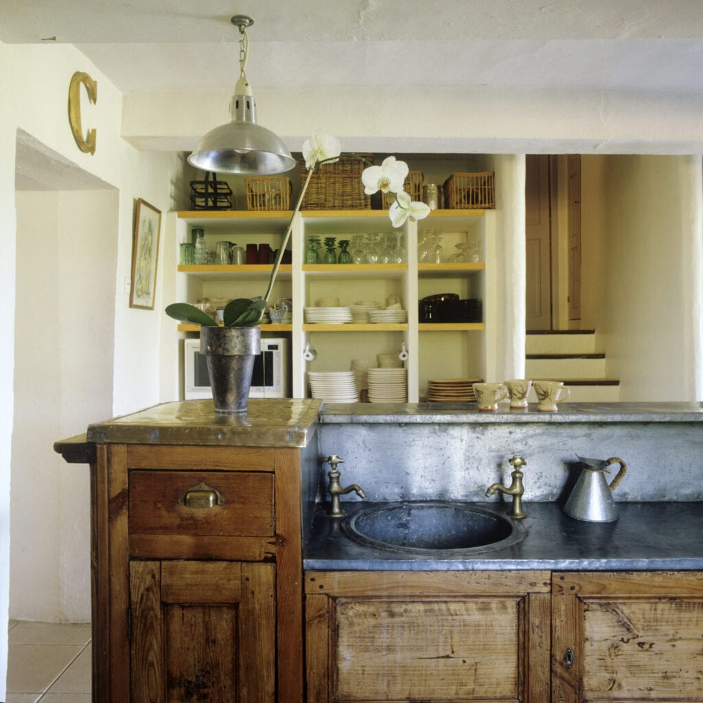 Luberon farmhouse renovation with zinc bar rescued from a fire in the Lacoste's Café