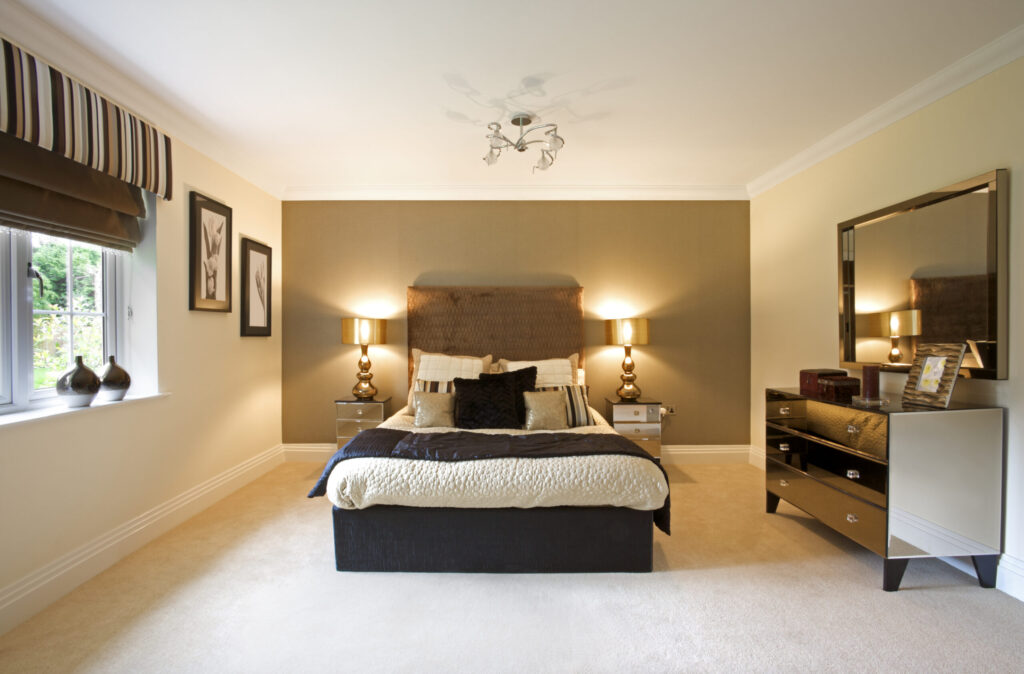 a luxury bedroom from an expensive new home. This has been prepared as the show home by a leading Interior Designer. It could also represent a luxury hotel room. Bright and spacious, this room depicts space and comfortable living.