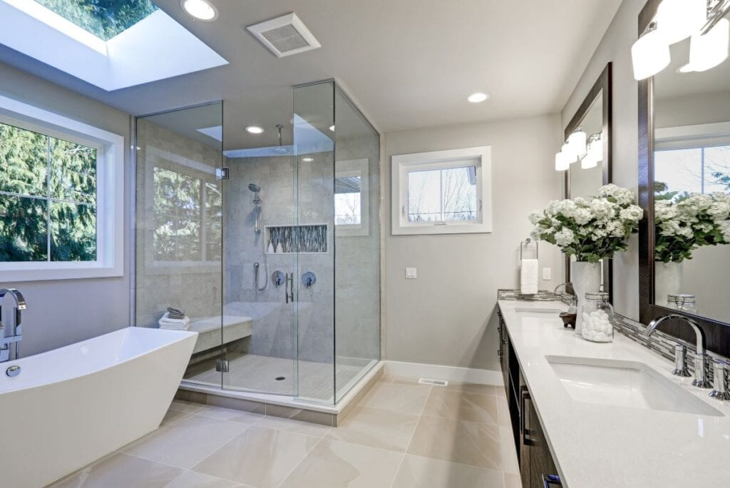 Transitional style bathroom with wood cabinets and glass shower