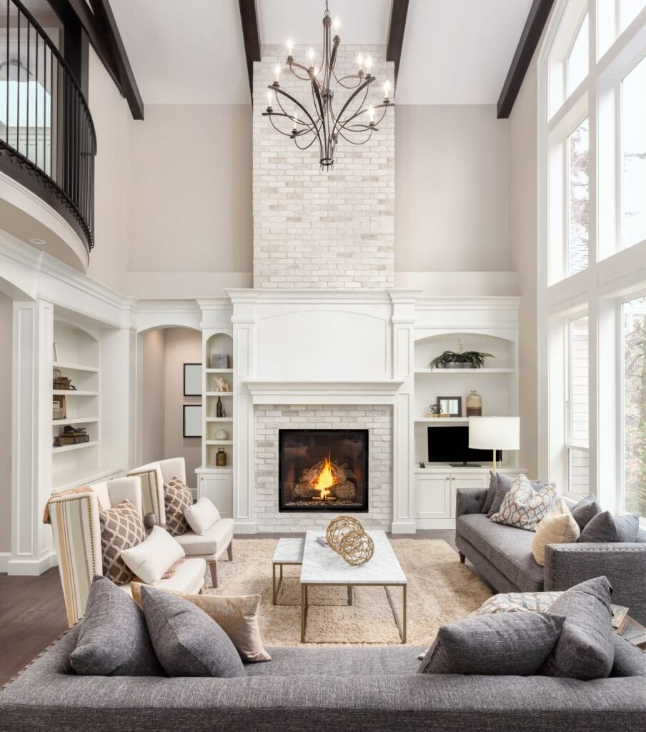Transitional style living room with high ceilings