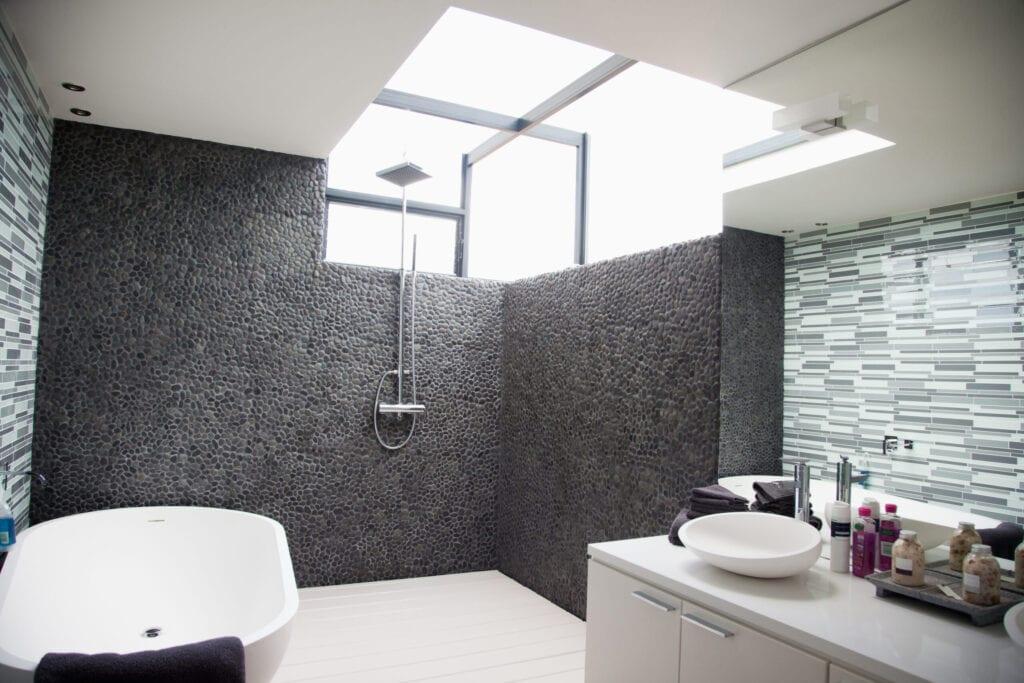 stone focal wall shower contemporary bathroom