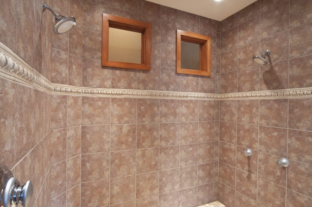 """""""This large, spacious shower, has double heads so two people can take a shower."""""""