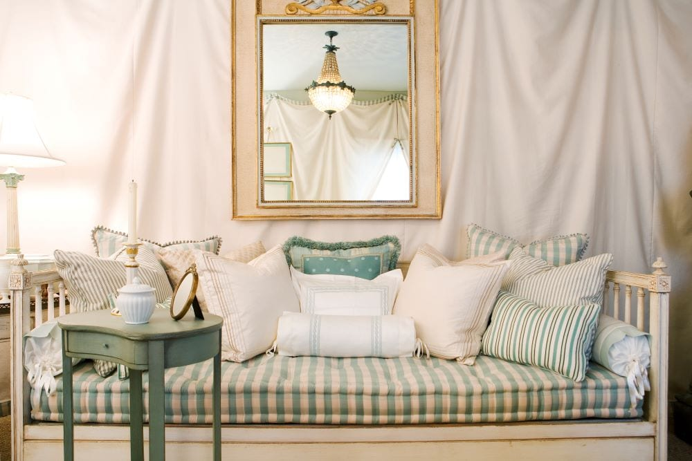 Vintage daybed with large mirror and teal side table